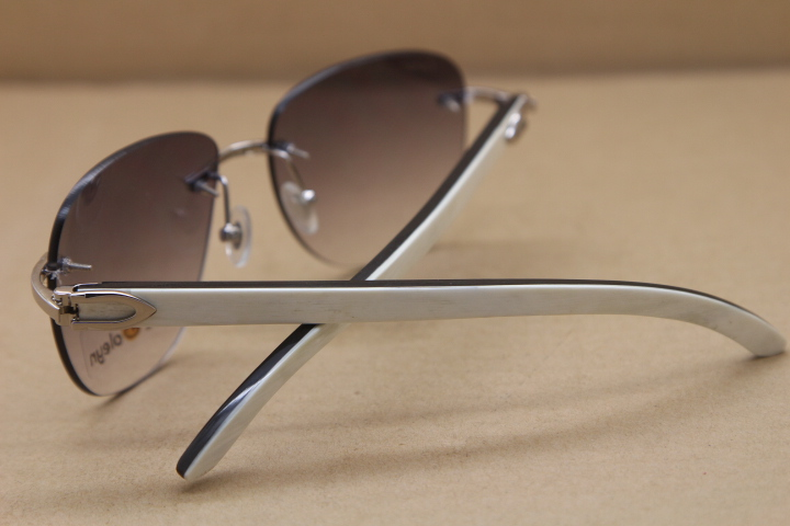 9c39f2d42f Product Name Cartier Rimless Sunglasses T8300680 Original Black Mix White  Buffalo Horn Sunglasses in Gold Brown Lens